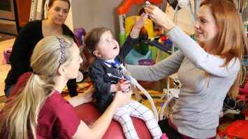 Zoey Jones, 3, works with therapists at her home in Nashville. Zoey is no longer a candidate for a heart lung transplant after doctors at Nationwide Children`s Hospital found a way to help restore normal blood flow to her lungs and follow-up surgery on her heart.
