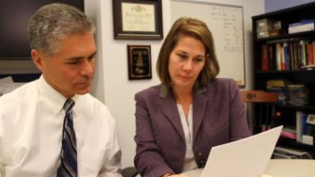 Pete Minneci, MD and Kate Deans, MD of Nationwide Children`s Hospital look over a study they authored that found 95 percent of children who were hospitalized for uncomplicated appendicitis could be successfully treated with antibiotics and sent home without undergoing traditional surgery.