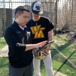 Jeremiah Cangelosi (right) reviews video of himself pitching with athletic trainer, Michael Macatangay. Being able to freeze the video and analyze the angles of his arm and body has helped Jeremiah make corrections to his throwing style to improve accuracy and prevent injuries.